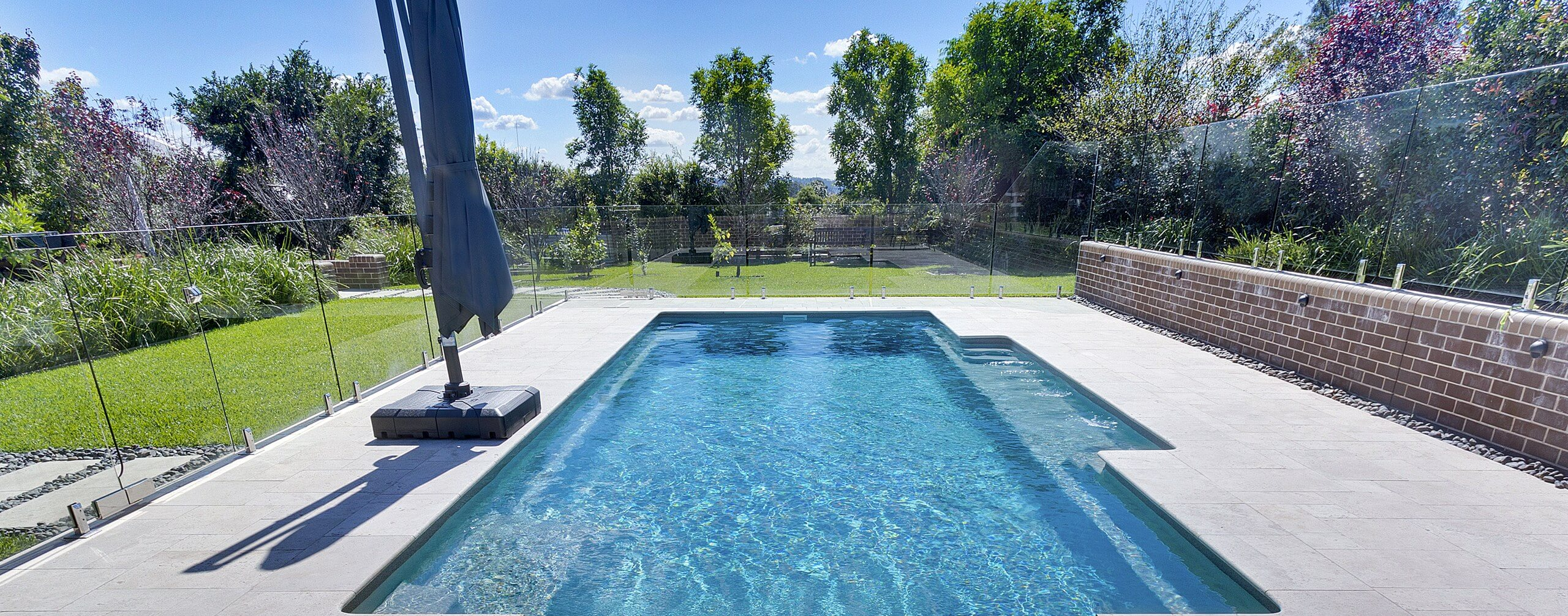 Compass Pools Australia Vogue fibreglass pools with bubblers on the bench