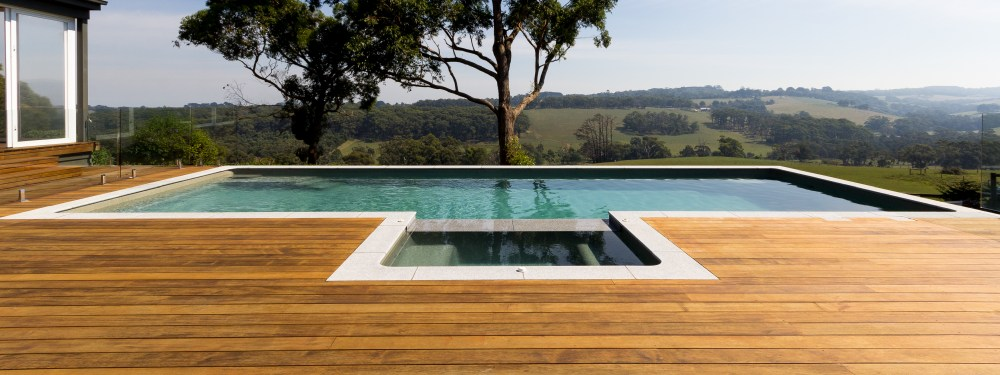 A pool and spa combination built above ground