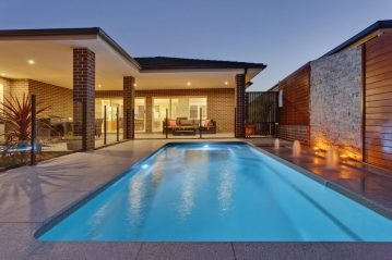 Compass Pools Australia A pool with sunpod by dusk