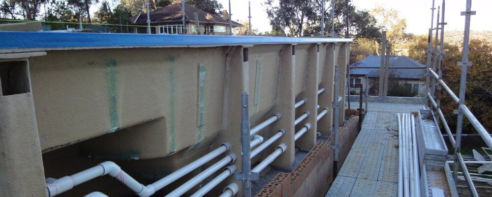 Above ground fibreglass pool installation with plumbing