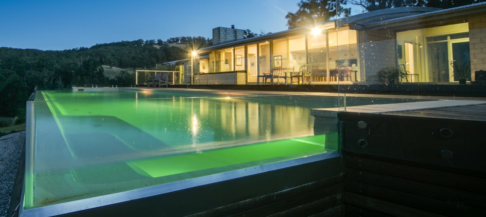 Above ground fibreglass pool with glass wall