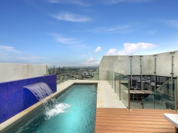 Compass Pools Australia Backyard pool design ideas Fastlane lap pool with a water wall feature