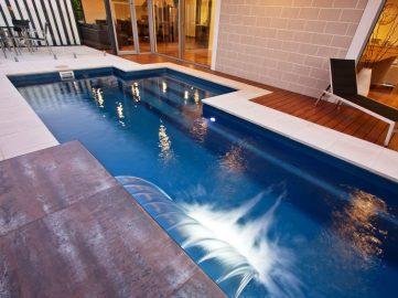 Compass Pools Australia Backyard pool design ideas Fastlane lap pool with water wall