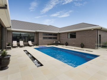 Compass Pools Australia Backyard pool design ideas X Trainer fibreglass pool with 2 bubbler water features