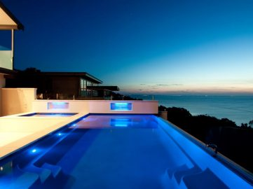 Compass Pools Australia Backyard pool design ideas X Trainer infinity swimming pool with a spa attached
