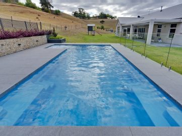 Compass Pools Australia Backyard pool design ideas X Trainer pool and spa combo