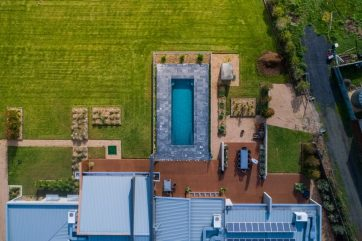 Beautifully landscaped backyard with X-Trainer pool as its centrepiece