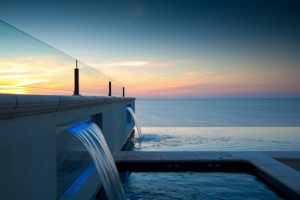 Compass Pools Australia Cost of infinity pools Inifnity pool inspirations Pool and spa combo with 2 water walls