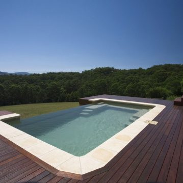 Compass Pools Australia Cost of infinity pools Inifnity pool inspirations X Trainer infinity pool with a wooden deck