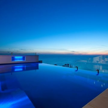 Compass Pools Australia Cost of infinity pools Inifnity pool inspirations X Trainer pool with a spa