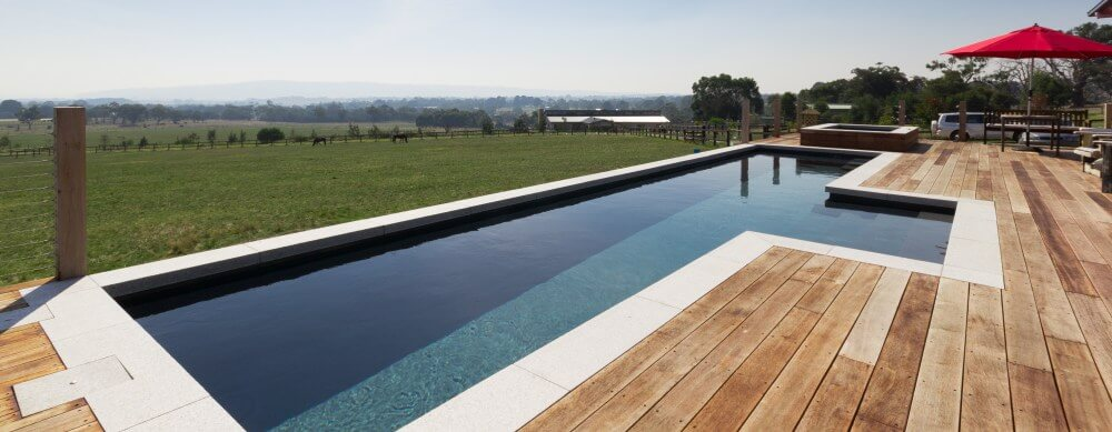 Fibreglass lap pool Fastlane built partially above the ground