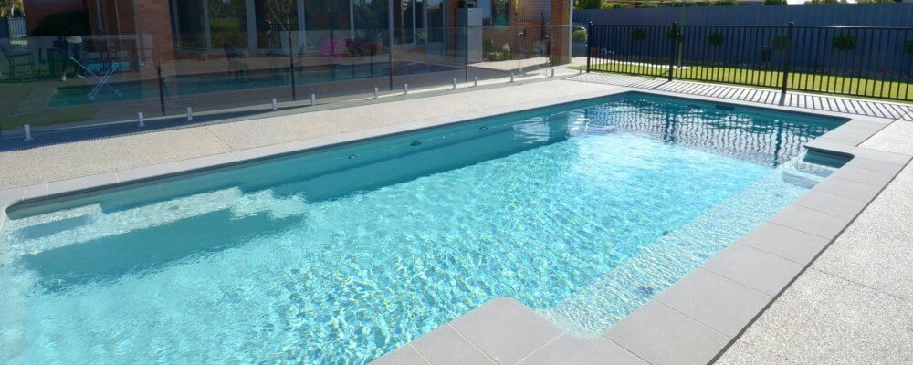 Glass fencing around the swimming pool