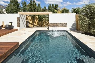 Highton X-Trainer fibreglass pool installation with water wall water feature