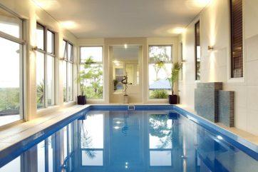 Indoor inground pool X-Trainer fibreglass pool with lights on