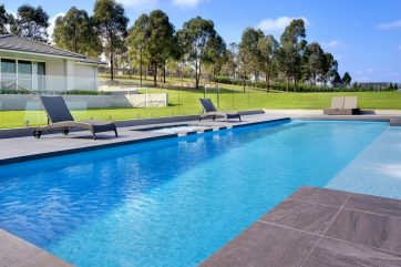 Large X-Trainer pool with a spa and 3 water wall features