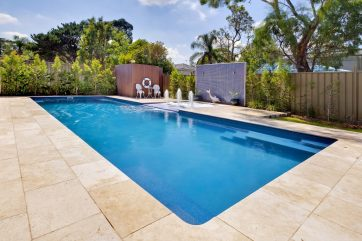 Outdoor inground pool X-Trainer with Sunpod water feature