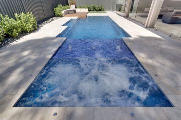 Compass Pools Australia Pool and spa combo with the sunpod water feature