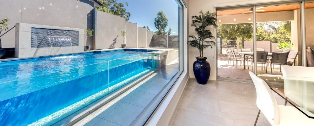Pool design ideas pool with glass wall and a water wall water feature