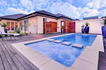 Compass Pools Australia Pool landscaping ideas Combination of tiles and wood makes the pool look very attractive
