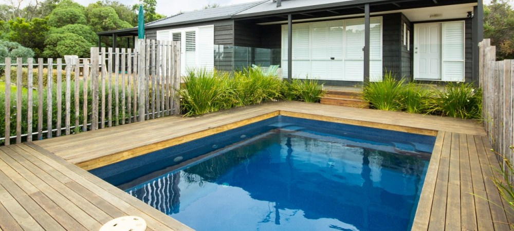 Simple small courtyard design with a plunge pool in its centre