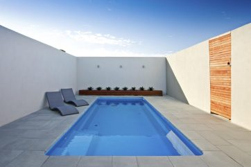 Simplistic pool landscaping of this outdoor entertaining area