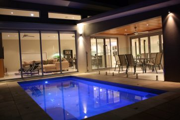 Smaller X-Trainer pool with automated pool cleaning system at night