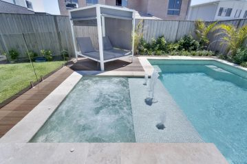 Compass Pools Australia Sunpod separating the pool and attached spa