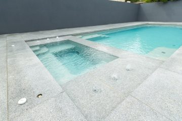 Compass Pools Australia Sunpod water feature surrounding the attached spa