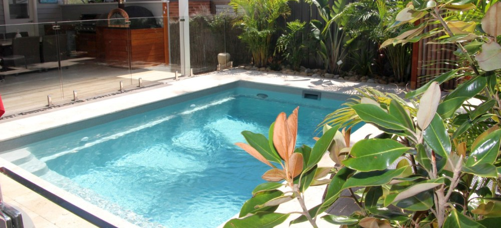 Tropical lush vegetation around a plunge pool