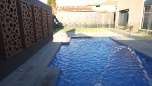 Vogue 8.2 Royal blue colour fibreglass pool installation in Melbourne VIC 02