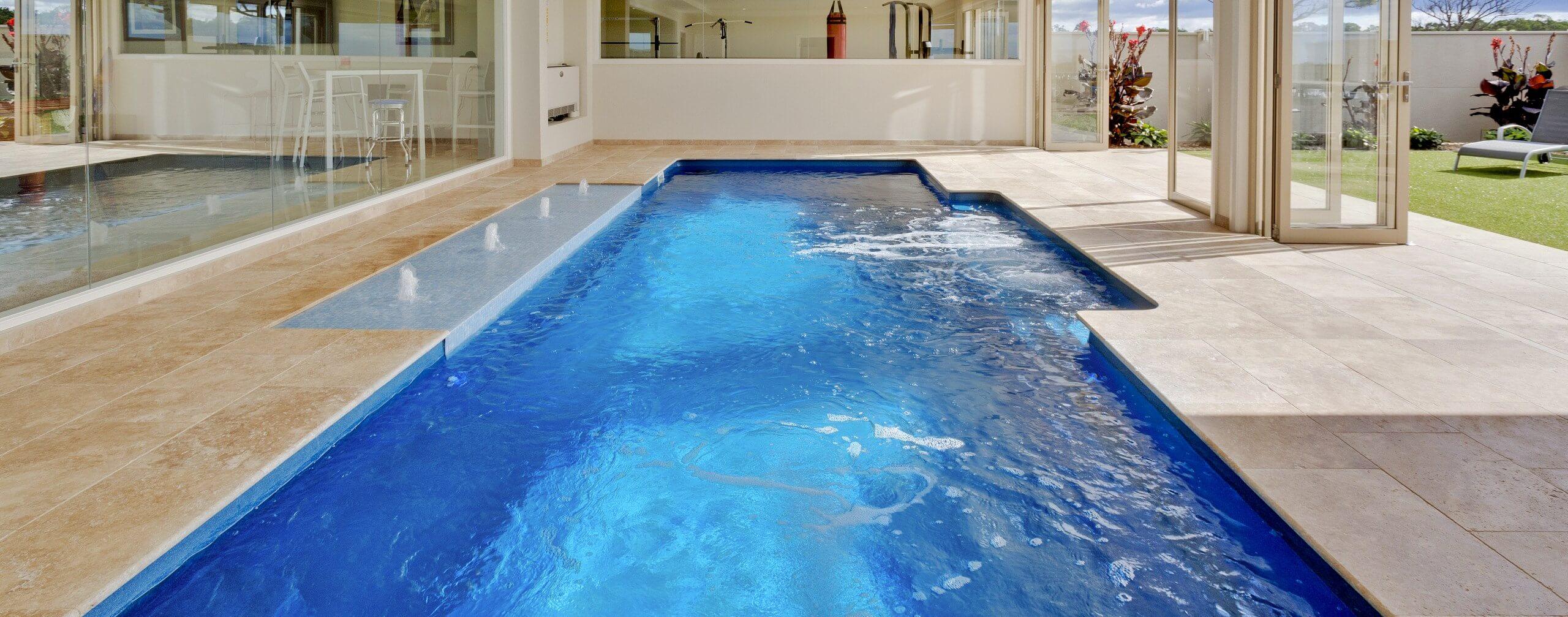 Compass Pools Australia Vogue fibreglass pool with bubblers and sunpod
