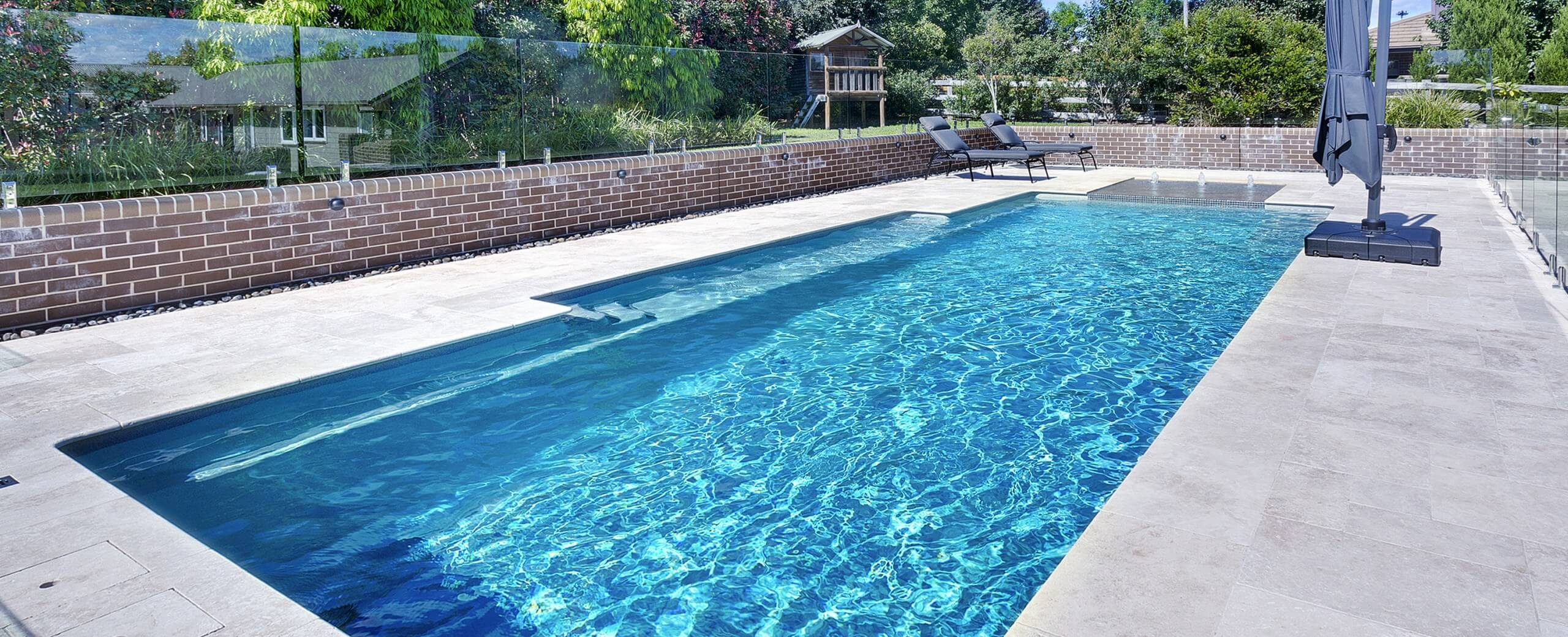 Compass Pools Australia Vogue pool shape header with Sunpod and Bubbler on the short side