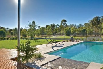 Compass Pools Australia Water features a fibreglass pool with sunpod
