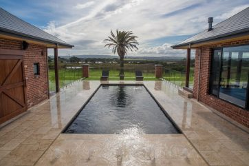 X-Trainer fibreglass pool with Sunpod water feature