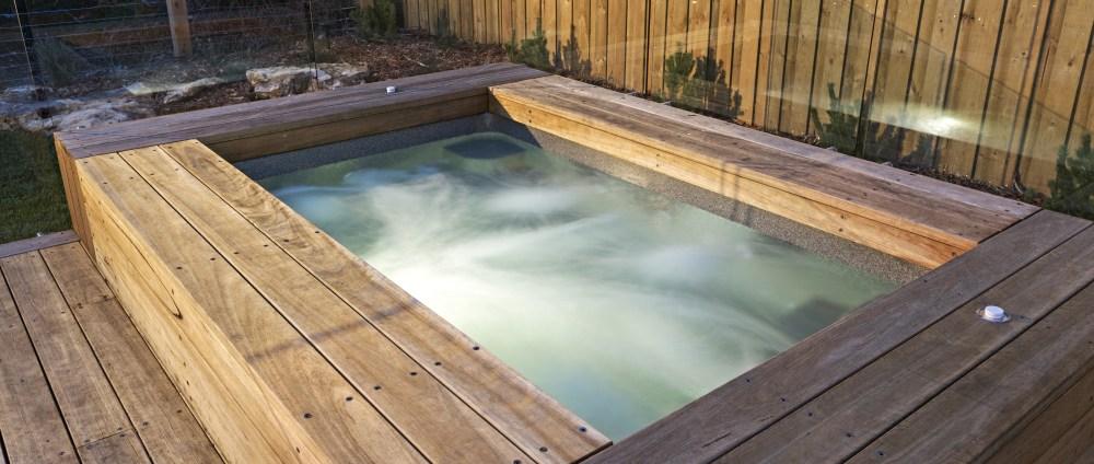 Compass Pools Australia X Trainer fibreglass spa built partially above the ground