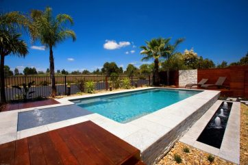 X-Trainer pool built partially above ground with Sunpod and another bubbler water feature