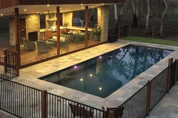 X-Trainer pool installation with pool lights on