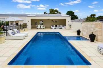 X-Trainer pool with Sunpod landscaped with pavers