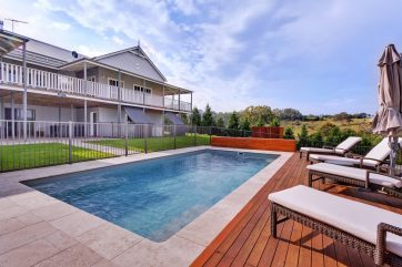 X-Trainer pool with a combination of pavers and timber decking