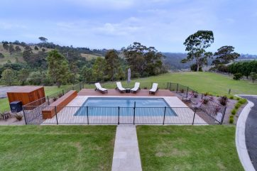 X-Trainer pool with a combination of pavers and timber decking another angle