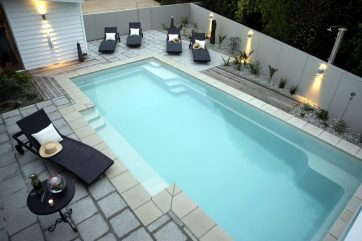 X-Trainer pool with tiles used for pool landscaping