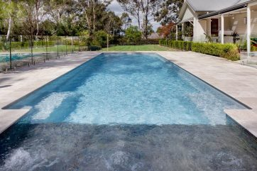 X-Trainer swimming pool installation with Sunpod water feature