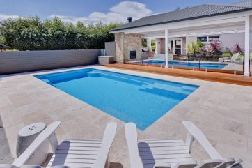 X-Trainer swimming pool with nice outdoor landscaping