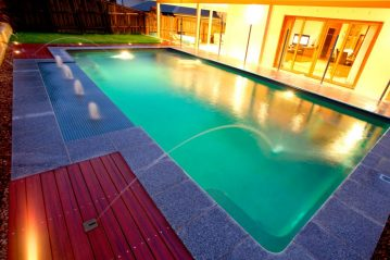 Compass Pools Australia X Trainer swimming pool with sunpod and deck jets