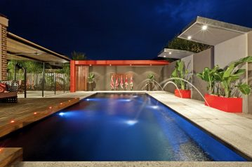 Compass Pools Australia X Trainer swimming pool with water feature deck jets