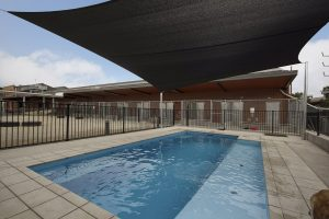 Compass Pools Melbourne X Trainer 8.2 self cleaning pool with custom ramp Kensington Victoria 2
