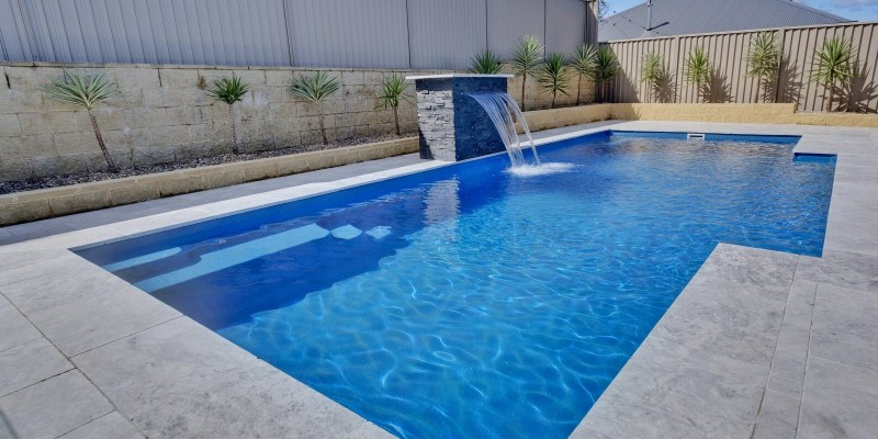 Compass Pools Vogue swimming pool shape with a water wall feature